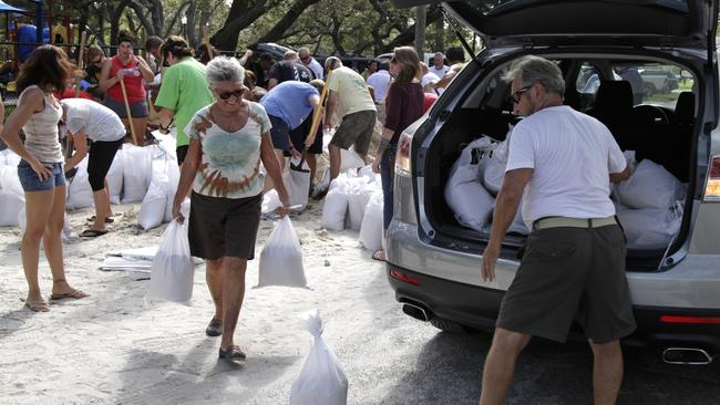 Communities are working together to fill sandbags and build banks. Picture: Lara Cerri