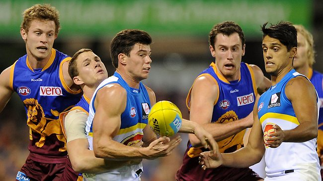 BRISBANE, AUSTRALIA - JULY 06: Jaeger O'Meara of the Suns handballs during the round 15 AFL match between the Brisbane Lions and the Gold Coast Suns at The Gabba on July 6, 2013 in Brisbane, Australia. (Photo by Matt Roberts/Getty Images)