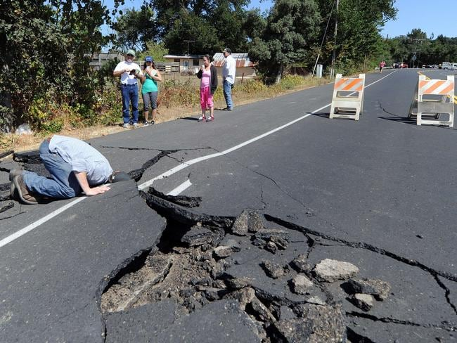 Under the surface ... A buckled highway just outside of Napa, California. Fears are held for the nearby uente Hills thrust fault which runs through the centre of Los Angeles. Source: AFP