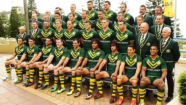 The Kangaroos pose for a team photo in Coogee before heading to the World Cup in the UK.