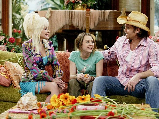 Goold old days ... Miley Cyrus' godmother Dolly Parton, Cyrus and Billy Ray Cyrus in a scene from 'Hannah Montana'.