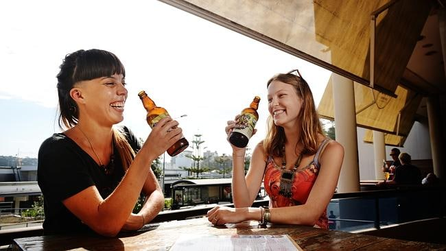 Adrianna Navarro and Annika Blauenjoying a Brookvale Union ginger beer in Manly.
