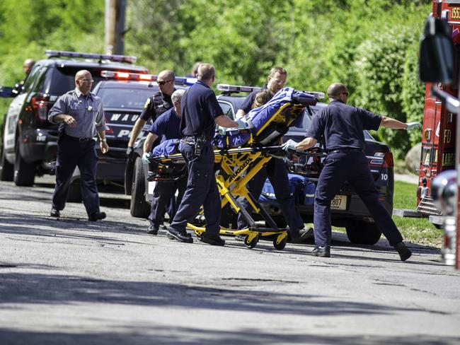 Attack: Rescue workers lift the 12-year-old stabbing victim to an ambulance. Picture: AP Photo/Abe Van Dyke