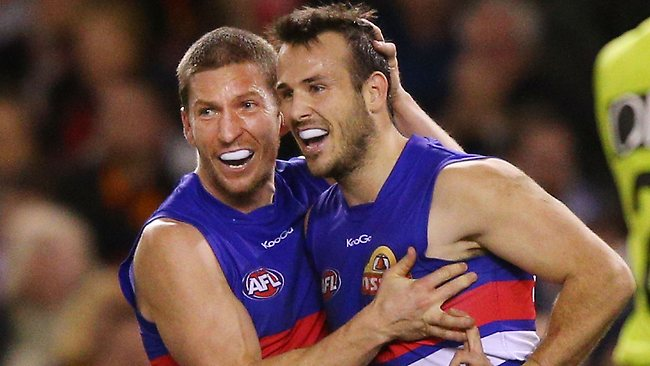 MELBOURNE, AUSTRALIA - AUGUST 18: Matthew Boyd (L) and Tory Dickson of the Bulldogs celebrate a goal during the round 21 AFL match between the Western Bulldogs and the Adelaide Crows at Etihad Stadium on August 18, 2013 in Melbourne, Australia. (Photo by Michael Dodge/Getty Images)