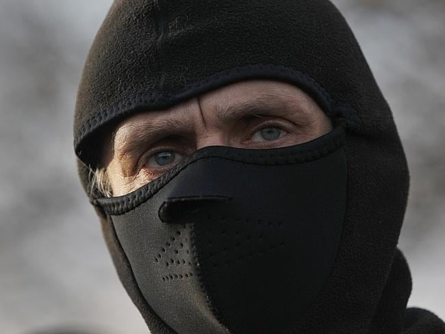 A pro-Russian activist makes barricades in front of the gate of an airport in Kramatorsk, eastern Ukraine, Tuesday, April 15, 2014.