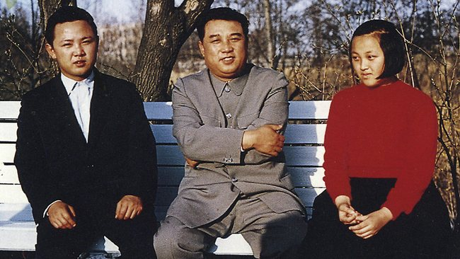 North Korean leader Kim il-sung flanked by his son Kim Jong-il and daughter Kim Kyong-hui in the garden of their home captial Pyongyang in 1963 photo released by North Korea's official Korean Central News Agency and distributed by Korea News Service.