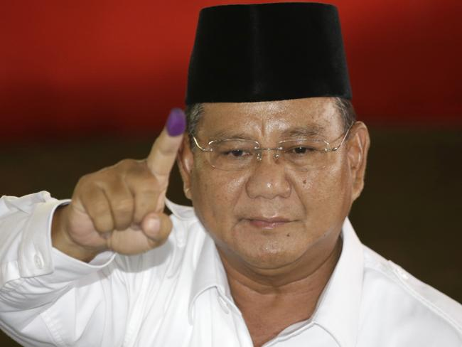 Not conceding ... presidential candidate Prabowo Subianto shows his ink-stained finger after casting his ballot. Picture: Achmad Ibrahim