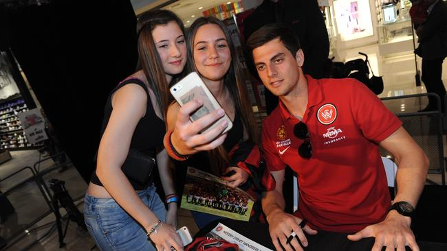 Western Sydney Wanderers striker Tomi Juric poses with adoring fans.