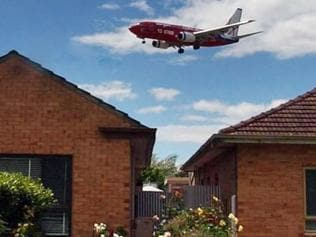 A plane comes into land at Adelaide Airport over housed in West Richmond.