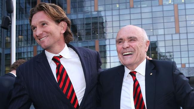 James Hird and Essendon president Paul Little embrace after the third and final day of the Essendon-ASADA Federal Court stoush.