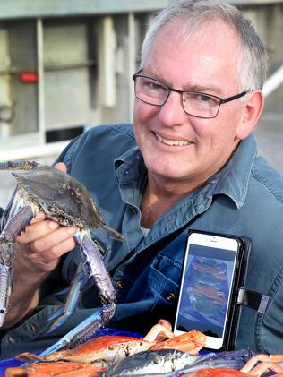 Crab fisherman Dennis Holder using the app at Port Adelaide. Picture: AAP/Dean Martin