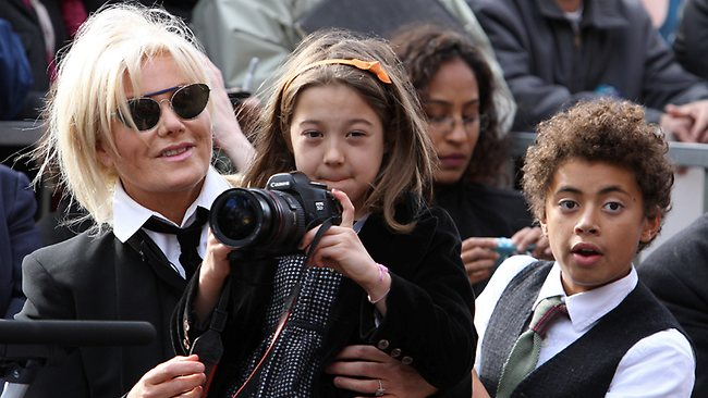Deborra-Lee, Ava and Oscar Jackman take photos of dad while receiving a Hollywood Walk of Fame star. Picture: Splash News