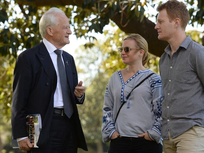 Philip Ruddock talks with Jody and Gavin Bannerman ahead of Saturday's council elections. Photo: Jeremy Piper