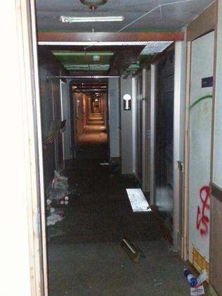 Empty hallway ... with passengers' items on the floor. Picture: Australpress
