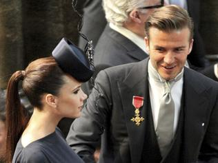 FILE- British soccer player David Beckham pats the stomach of his pregnant wife Victoria, as they attend the wedding of Britain's Prince William and Kate Middleton at London's Westminster Abbey, in this file photo dated Friday April 29, 2011. Spokesman for David Beckham, Simon Oliveire says Sunday July 10, 2011, that Victoria Beckham has given birth to a healthy baby girl, at a hospital in Los Angeles, U.S. adding to their family of three boys, Brooklyn, 11, Romeo, 8, and Cruz, 5. (AP Photo/Jon Bond, file)