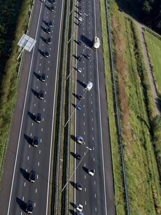 The convoy of hearses carries the bodies of victims of the downed Malaysia Airlines flight MH17. Picture: AFP Photo/ANP/Jerry Lampen