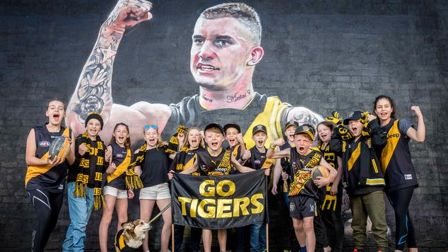 Tigers fans are expected to flood the streets if Richmond wins on Saturday. Picture: Jake Nowakowski