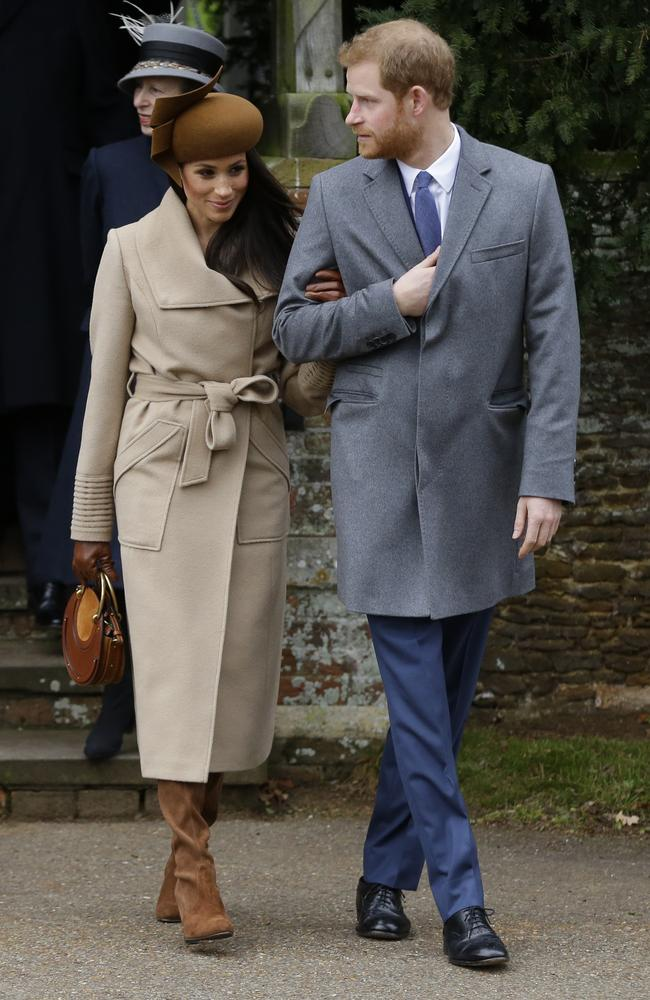Prince Harry and his fiancee Meghan Markle arrive to attend the traditional Christmas Day service, at St. Mary Magdalene Church in Sandringham. Picture: AP