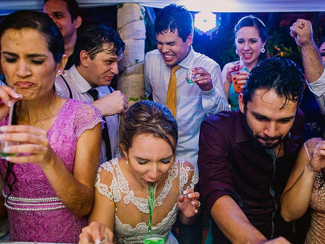 This bride immediately said hello again to a bright green shot she'd just had at her reception. Picture: MARIA ERLICH / ISPWP / CATERS NEWS