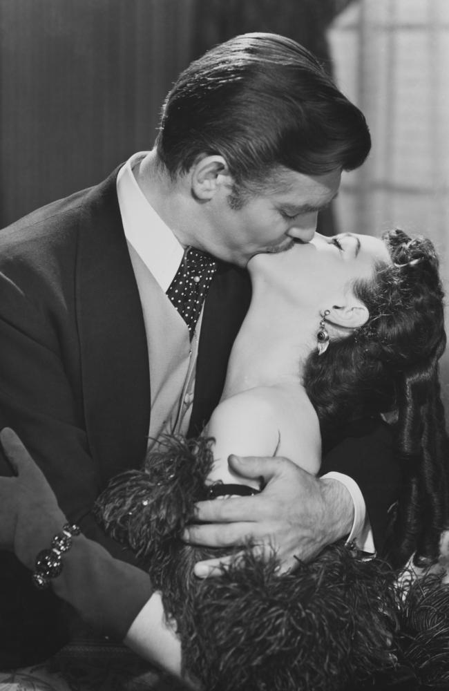 Clark Gable, as Rhett Butler, plants a smacker on Vivien Leigh's Scarlett O'Hara in Gone With the Wind.