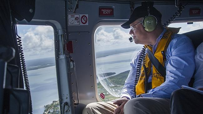 Border Protection Minister Scott Morrison flying over the Torres Strait Islands yesterday. Picture: Brian Cassey