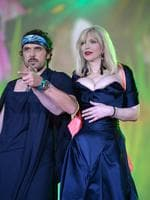 Singer Courtney Love wears an eye-poppingly revealing gown as she appears stage during the Lifeball 2014 at City Hall on May 31, 2014 in Vienna, Austria. Picture: Getty
