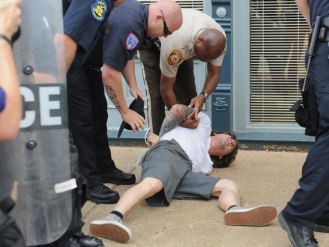 A man is arrested during a protest of the shooting death Michael Brown outside Ferguson Police Department Headquarters. Photo: Michael B. Thomas/Getty Images/AFP
