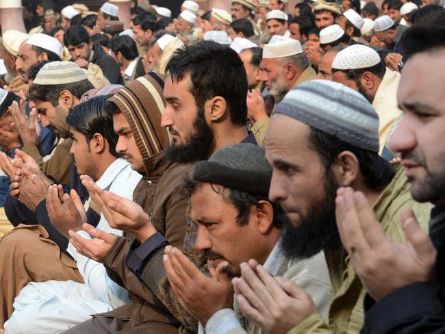Mourning ... Pakistani Muslims pray for children and teachers killed by Taliban militants. Picture: AFP