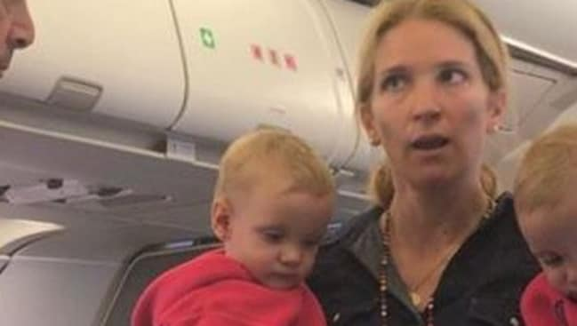 Supplied Editorial woman with twins sobbing american airlines