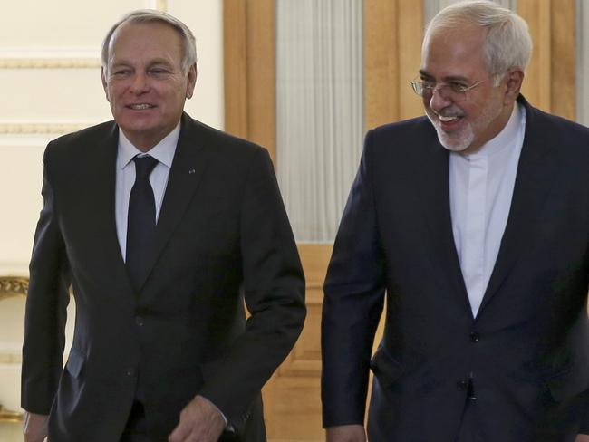 Iranian Foreign Minister Mohammad Javad Zarif, right, and his French counterpart Jean-Marc Ayrault, arrive for their meeting in Tehran, Iran. Picture: AP