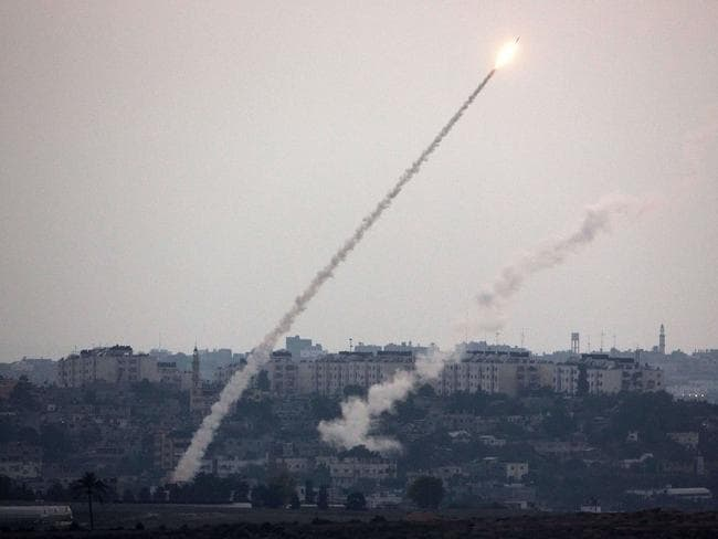 Blind firing ... This picture taken from the southern Israeli Gaza border shows rockets being launched from the Gaza strip into Israel.