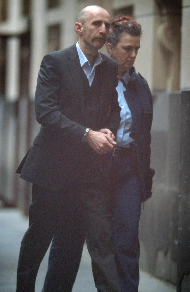 Convicted murderer Julian Knight arrives in the prison van at the Melbourne Supreme court.