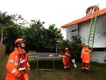 SES volunteers put a tarp on a house in Torakina Street, Aitkenvale, Townsville. Picture: Evan Morgan