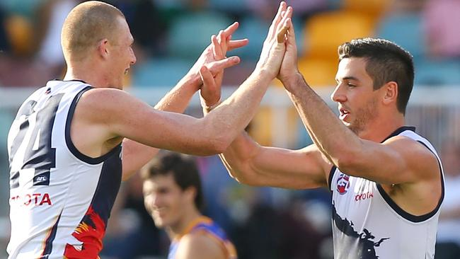 Crows forward Taylor Walker celebrates a goal with ruckman Sam Jacobs. Picture: Chris Hyde