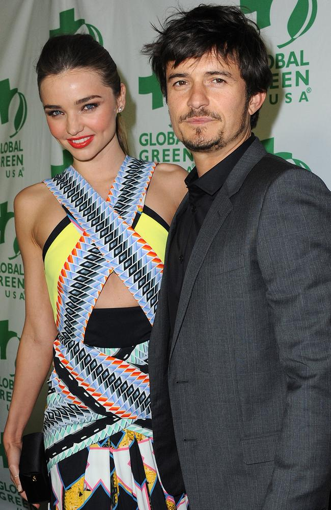 Happier times ... Miranda Kerr and Orlando Bloom arrive at Global Green USA s 10th Annual Pre-Oscar Party in LA before their separation. Picture: AP