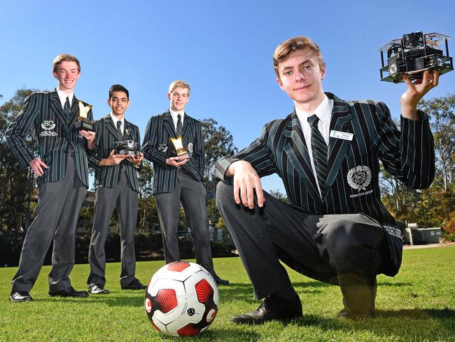 Team captain Lachlan Grant (front) with fellow BBC RoboCup representatives (from left) Sam Tudor, Nakul Doshi and James Yelland fresh from their triumph in Japan. Picture: John Gass/AAP