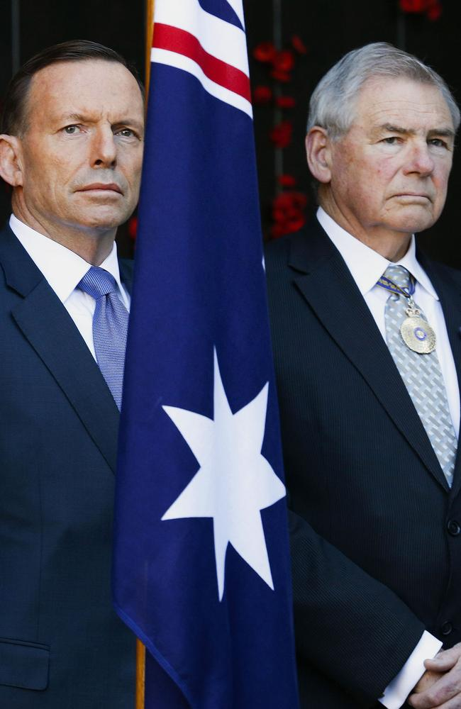Served side-by-side in the iraq war ... Australia's Prime Minister Tony Abbott (L) and Ken Doolan (R), RSL National president. Picture: AFP