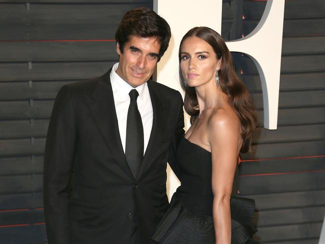 tourist wants to expose david copperfield s tricks after he was  david copperfield wife chloe gosselin at the 2016 vanity fair oscars party picture