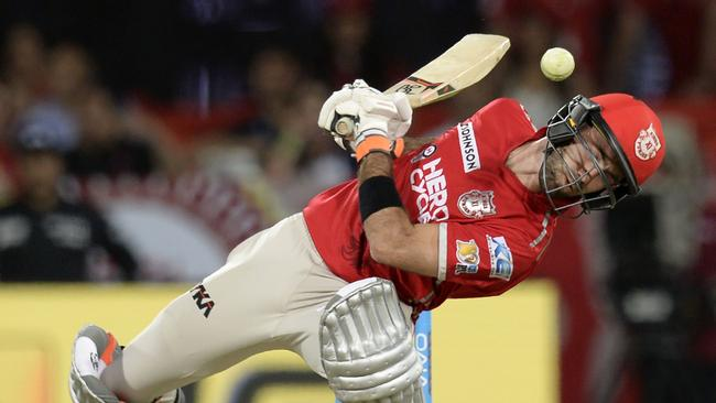 Kings XI Punjab cricketer Glenn Maxwell ducks to leave a ball during the 2017 Indian Premier League (IPL) Twenty20 cricket match between Kings XI Punjab and Mumbai Indians.