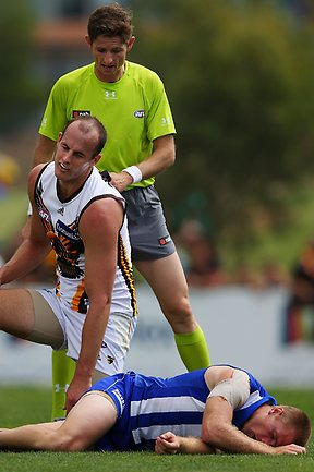 CRAIGIEBURN, AUSTRALIA - MARCH 16: Leigh Adams of the Kangaroos lies on the ground after getting hit in the head by David Hale of the Hawks when contesting for the ball during the AFL NAB Cup match between the North Melbourne Kangaroos and the Hawthorn Hawks at Highgate Recreational Reserve on March 16, 2013 in Craigieburn, Australia. (Photo by Michael Dodge/Getty Images)