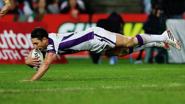 Melbourne's Billy Slater scores a try.