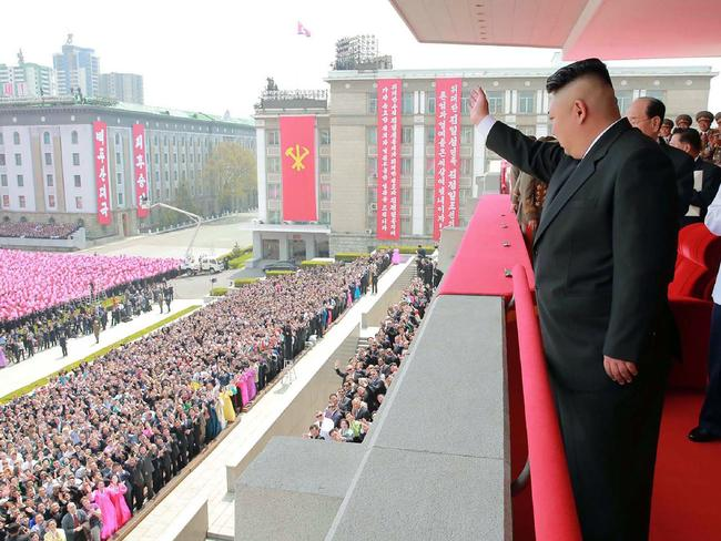 Kim Jong-un waves to the crowds after the military parade in Pyongyang last Friday. Picture: AFP