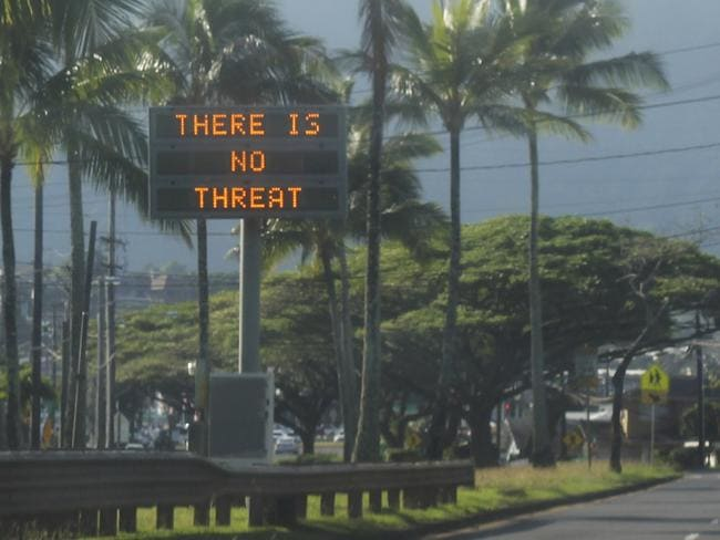 A highway sign tells locals 'There is no threat' in Kaneohe, Hawaii. Picture: Jhune Liwanag/AP