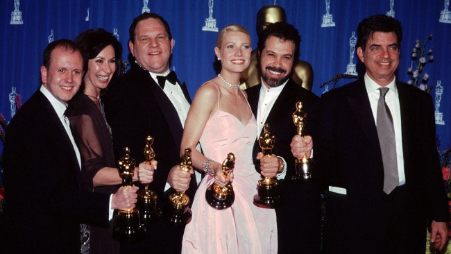 Harvey Weinstein and Gwyneth Paltrow (centre) at the 1999 Oscars after winning for 'Shakespeare In Love'. Photo: File