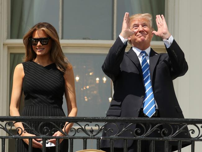 President Donald Trump, accompanied by first lady Melania Trump, gestures at the White House in Washington. Picture: AP/Andrew Harnik