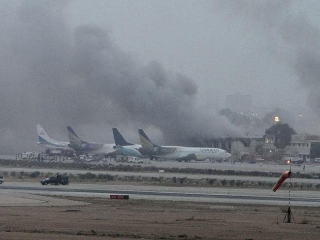 Deadly attack ... Smoke rises above the Jinnah International Airport after security forces quelled an attack by Taliban militants.