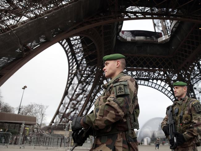 French soldiers patrol the Eiffel Tower in Paris as the capital was placed under the highest alert status. Picture: Joel Saget