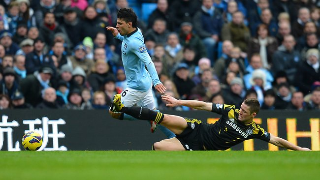 Chelsea'sGary Cahill (R) slides in to challenge Manchester City's Sergio Aguero in the English Premier League match at the Etihad Stadium. Picture: Andrew Yates