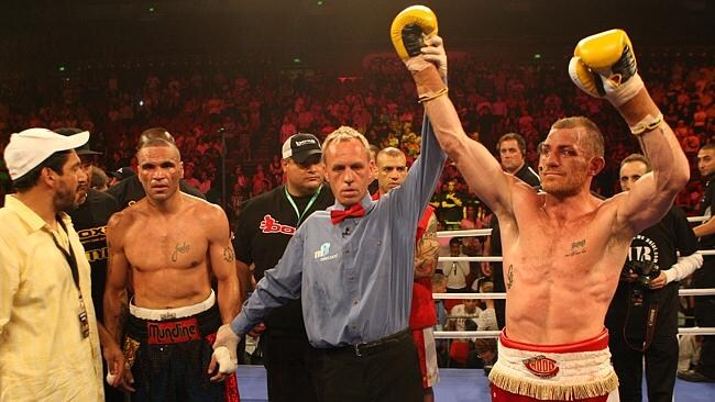 Anthony Mundine and then manager Khoder Nasser in shock as referee Les Fear lifts the arm of winner Garth Wood in the 2010 Mundine v Wood fight in Sydney.
