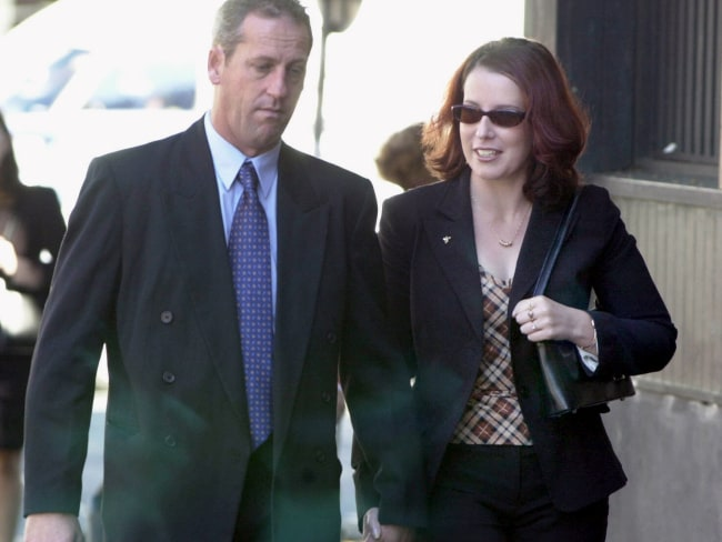 Craig Folbigg, estranged husband of Kathleen Folbigg, and his fiancee Helen enter the Supreme Court during Kathleen's trial in 2003. Photo: Ross Schultz.